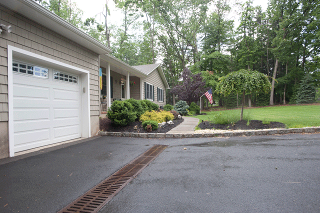 Driveway drainage system installed with grating and proper
