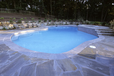Swimming pool with blue stone decking