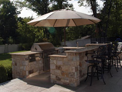 Natural Stone Outdoor Kitchen and Bluestone Patio