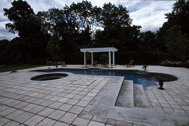 swimming pool with patio and pergola