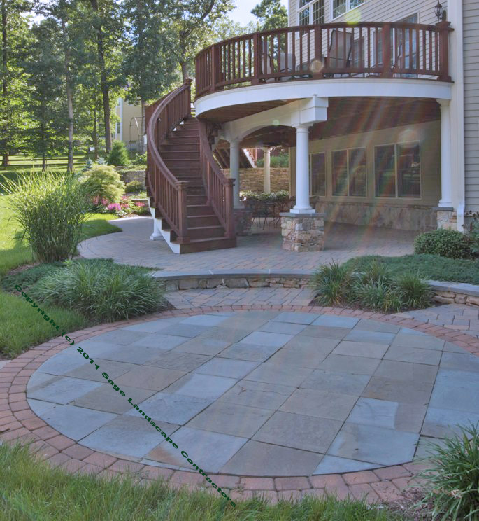 Bluestone Flagstone Patio With Brick Paver Border. Techo Bloc® Paver Patio  Under The Raised Wooden Deck.